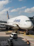 Workers prepare loading aircraft, vertical, Frankfurt, Germany stock photography