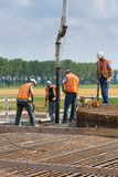 Workers preparing a concrete foundation of a Dutch wind turbine Stock Photography