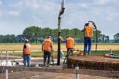 Workers preparing a concrete foundation of a Dutch wind turbine Stock Photos