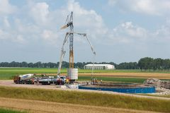 Workers preparing a concrete foundation of a Dutch wind turbine Royalty Free Stock Image