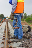 Workers preparing equipment for maintenance of the railway-Edit. Stock Photos