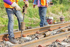 Workers preparing equipment for maintenance of the railway-Edit. Royalty Free Stock Photo