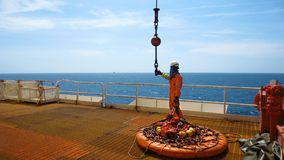 Workers are preparing the personal basket to lift by the crane to the offshore platform,. Transfer crews by personal basket from the platform to crews boat royalty free stock photo