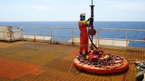 Workers are preparing the personal basket to lift by the crane to the offshore platform,. Transfer crews by personal basket from the platform to crews boat royalty free stock image
