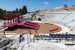 Workers preparing stage in the Greek theatre of Syracusa, Sicily Stock Photography
