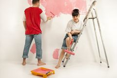 Workers preparing to painting a wall Stock Photography