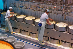 Workers during the process of production of Gruyere cheese at th Stock Images