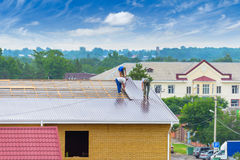 Workers produce work on roofing Royalty Free Stock Photo