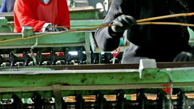 Workers and Production machines in operation stock footage