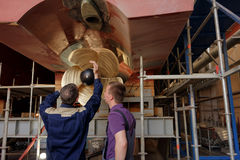 Workers at the propeller of passenger vessel Royalty Free Stock Photo