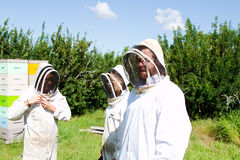 Workers with protective gear. For working with bees stock images