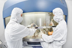 Workers in protective uniform at laboratory Stock Photo