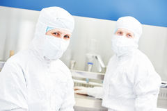 Workers in protective uniform at laboratory Royalty Free Stock Photos