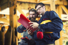 Workers in protective uniforms royalty free stock photography