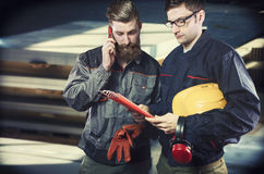 Workers in protective uniforms Stock Photo