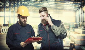 Workers in protective uniforms Royalty Free Stock Photo
