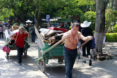 Workers pull wooden handcart Royalty Free Stock Image