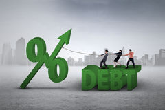 Workers pulling percentage sign of debt Royalty Free Stock Photo