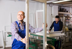 Workers with PVC windows and doors Stock Photography