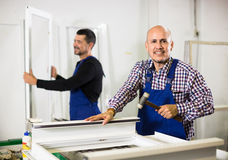 Workers with PVC windows and doors Royalty Free Stock Image