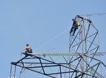 Workers on Pylon Royalty Free Stock Photo