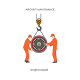 Workers raised the aircraft engine on a lift. Repair and mainten Royalty Free Stock Photography