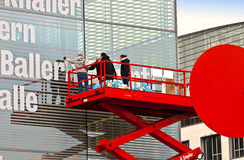 Workers on red telescopic platform Stock Photo