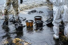 Workers remove crude oil from a beach Stock Photography