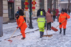 Workers remove snow Royalty Free Stock Images