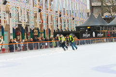 Workers removes snow on the rink Stock Photography