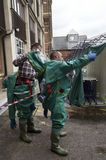 Workers removing decontamination suits Stock Photo