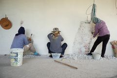 Workers removing the plastered cement surface on the bricklayer royalty free stock photography