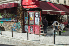 Workers renovate Cafe des Delices in Belleville, Paris, France Stock Photo