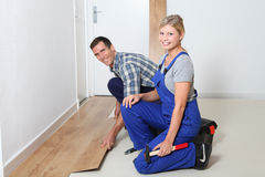 Workers renovating home Royalty Free Stock Images