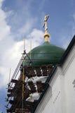 Workers repair church cupola. Stock Photos