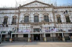 Workers repair Civic And Municipal Affairs Bureaumore in Macau Royalty Free Stock Image