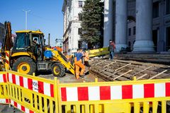 Minsk, Belarus, April 4, 2018: Workers repair the entrance staircase to the building Royalty Free Stock Images