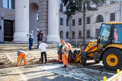 Minsk, Belarus, April 4, 2018: Workers repair the entrance staircase to the building Stock Photo