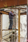 Workers repair the facade of the building. Stock Photos