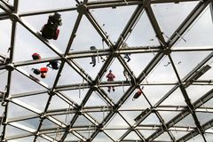 Workers repair the glass roof of philharmonic Stock Images
