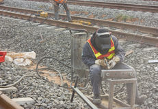 Workers repair the railway with Sandblasted. Workers repair the railway tracks with Sandblasted Stock Image