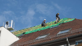 Workers Repair a roof after a fire royalty free stock photography