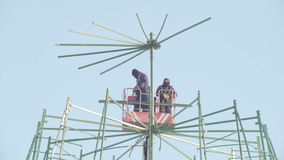 Workers repairing construction work in high place - making new year pine for celebrate stock video