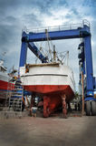 Workers repairing a fishing boat Stock Image