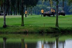 Workers repairing the golf field Royalty Free Stock Photos