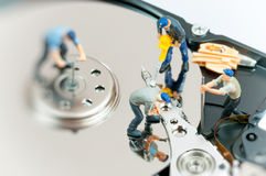 Workers repairing hard drive. Stock Photos