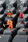 Workers repairing keyboard Royalty Free Stock Photography