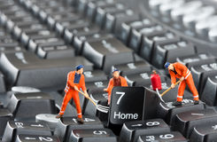 Workers repairing keyboard Stock Photography