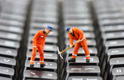 Workers repairing keyboard Stock Photo