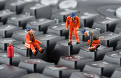 Workers repairing keyboard Stock Photos